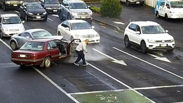 Auckland police are hunting a man who stole a car, hit its driver and sped away