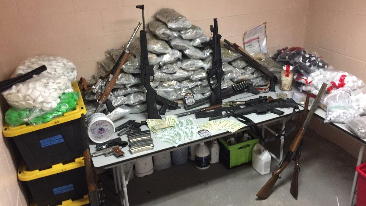 Sub-machine gun, assault rifles, $250K in drugs seized after fire