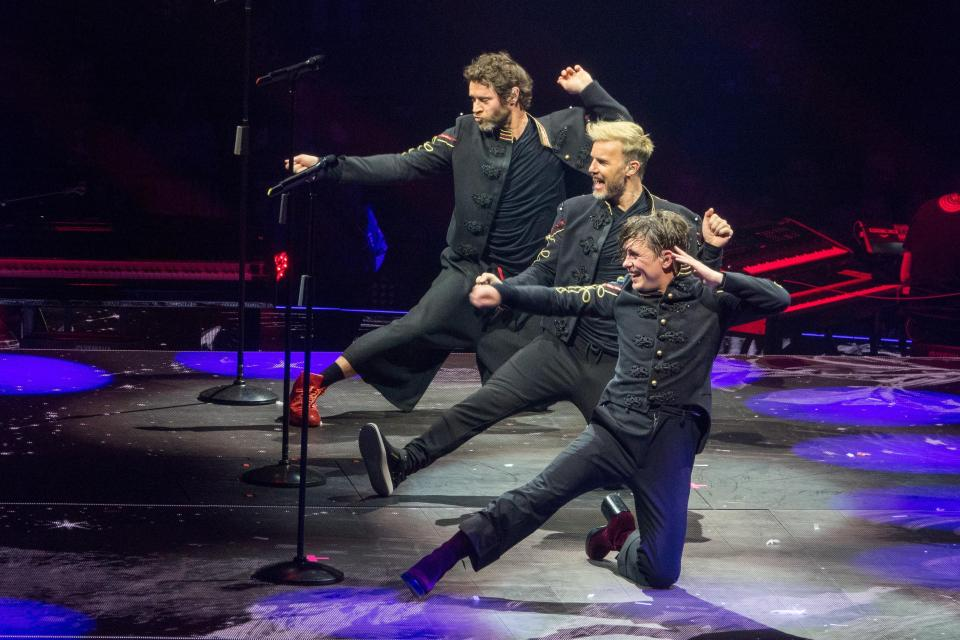 When is the Take That 2017 Wonderland tour and which UK dates have been rescheduled due to the Manchester bombing?
