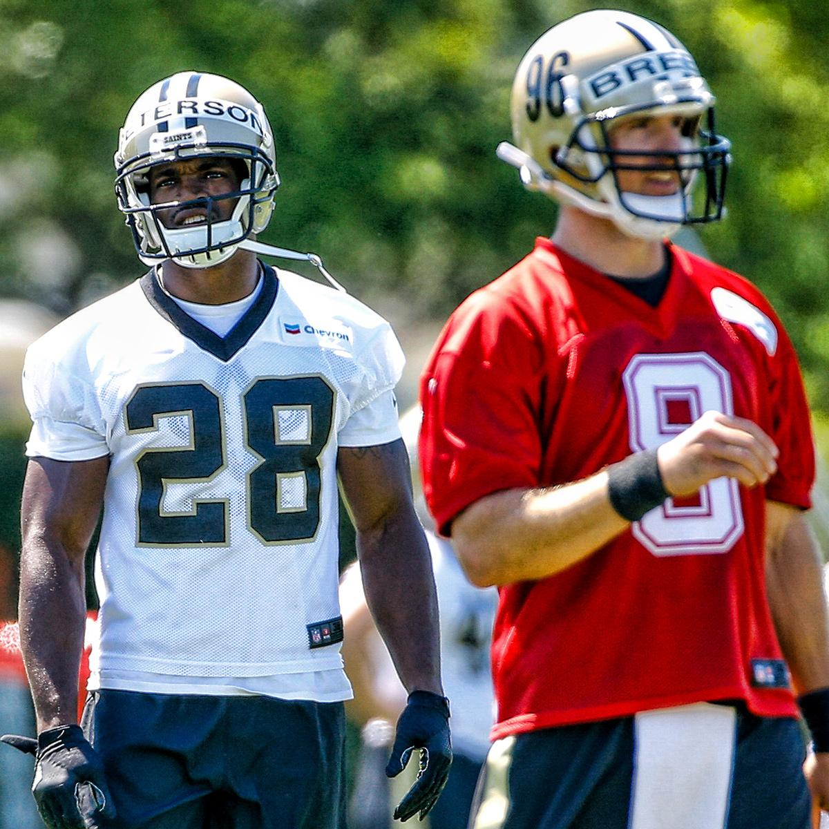 .@AdrianPeterson and @drewbrees take the field at @Saints OTAs!