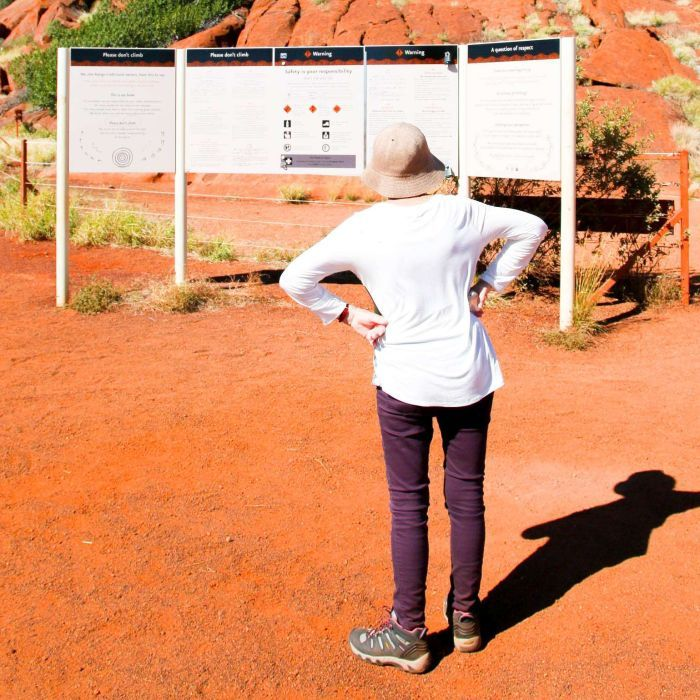 Uluru climb in Northern Territory should be banned, some tourists say