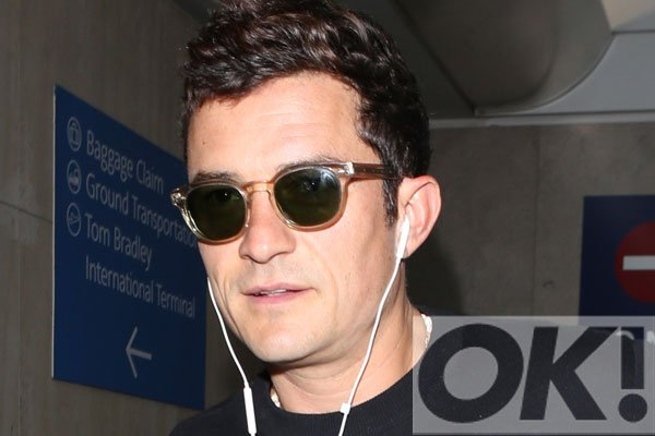 How adorable! Orlando Bloom was spotted at the airport with the CUTEST pet pooch ever