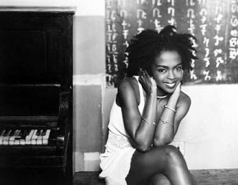 Happy Birthday to Lauryn Hill, a beautiful female singer of rap and soul and a wink also miles davis