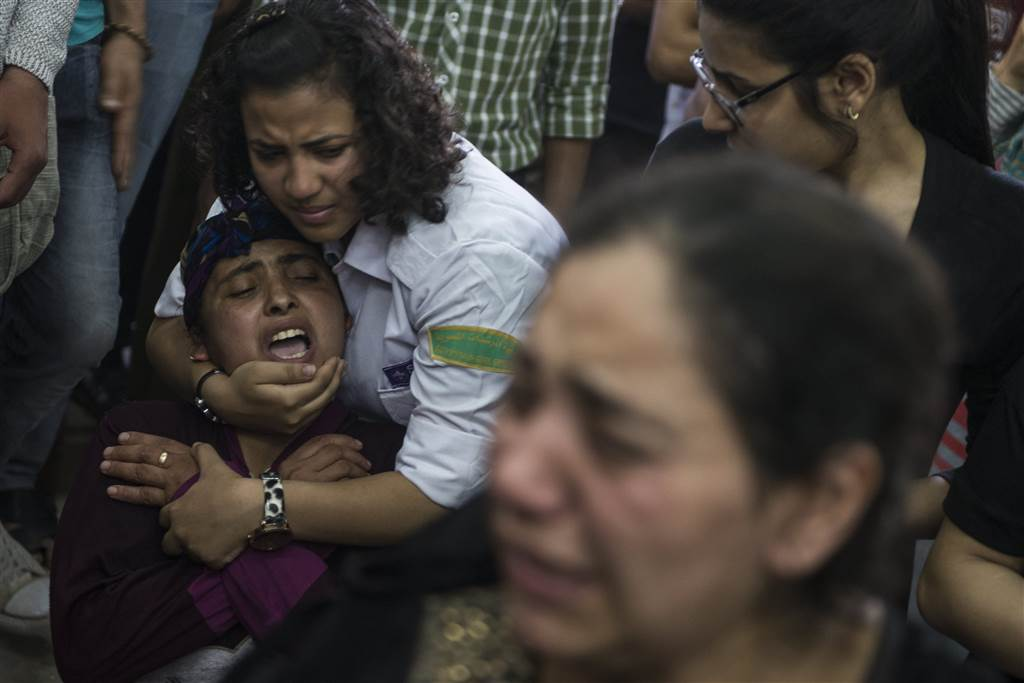 Coptic Christians mourn victims of Egypt bus attack. See more: