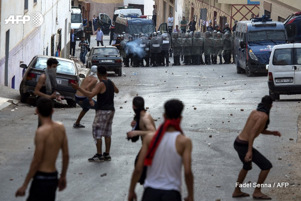 Police fire tear gas at protesters in restive Moroccan city