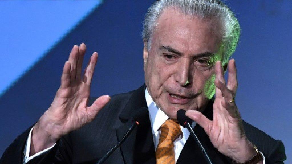Brazil's economy to grow again -- but few celebrating