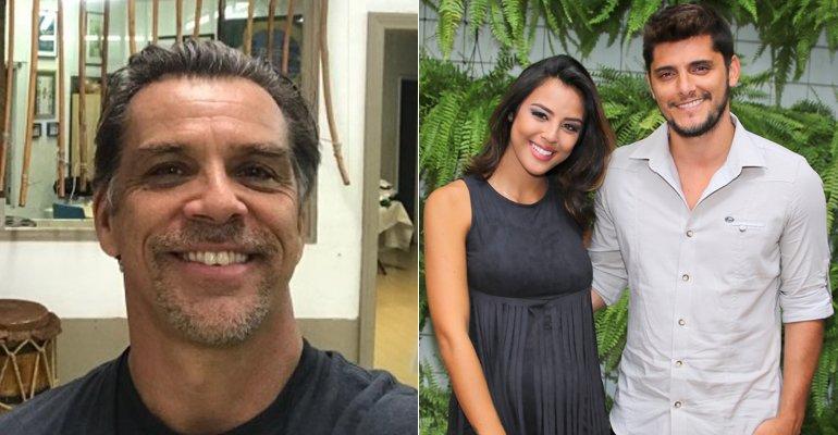 Beto Simas. Foto do site da Caras Brasil que mostra Beto Simas, padrasto de Bruno Gissoni, dá colo para a neta, Madalena. Veja a fofura
