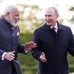 Putin, Modi talk up trade at Russia's economic showcase