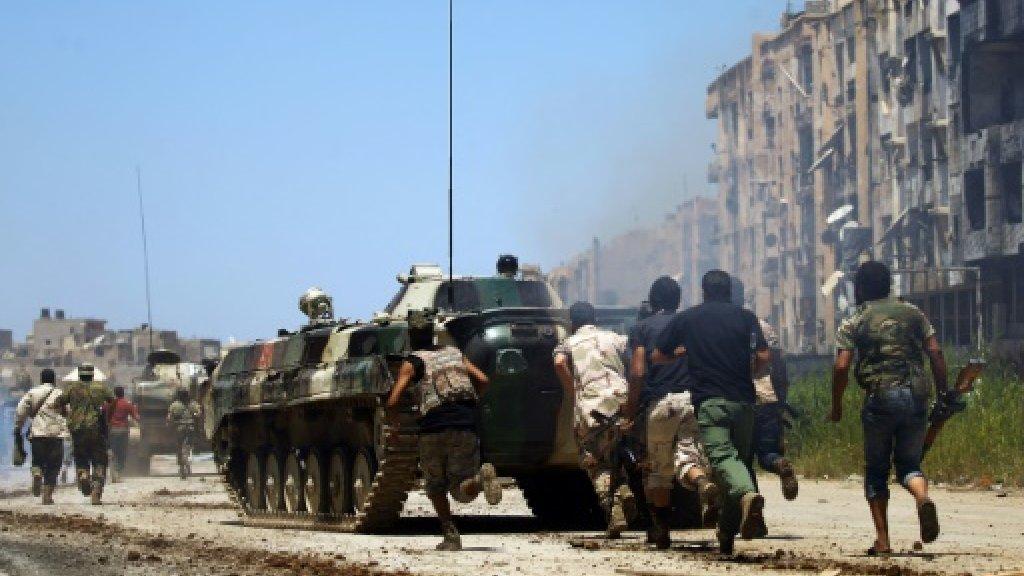 Libya strongman's forces say take southern desert base