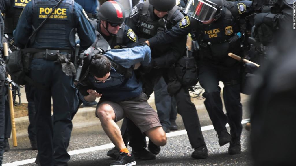 At least 14 people were arrested on Sunday amid competing protests in Portland, Oregon