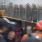 Venezuela opposition accuses security forces of robbing protesters