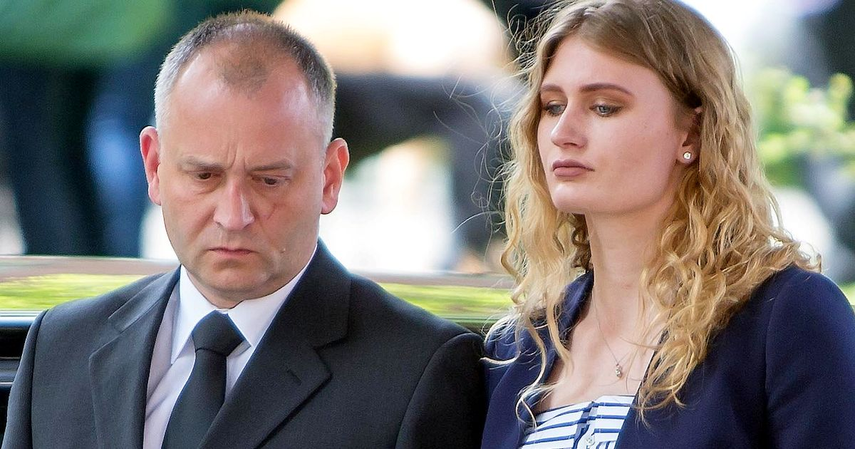Grieving dad and daughter hold hands as funeral of mum and son 'stabbed to death at home' takes place
