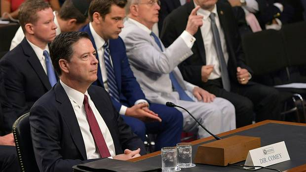 Trump in spotlight as fired FBI director Comey's testimony begins