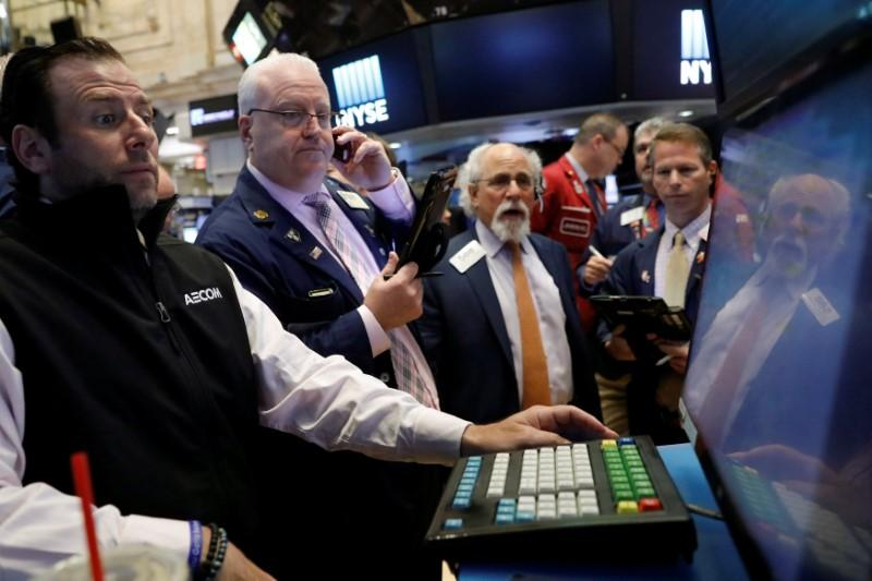 Wall St. slightly higher on healthcare; oil steadies