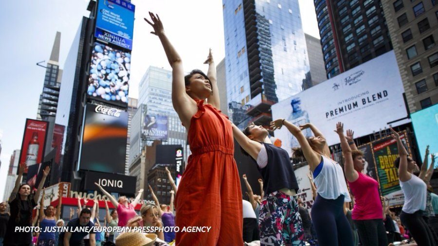 People around the world are striking poses on the International Day of Yoga. See photos