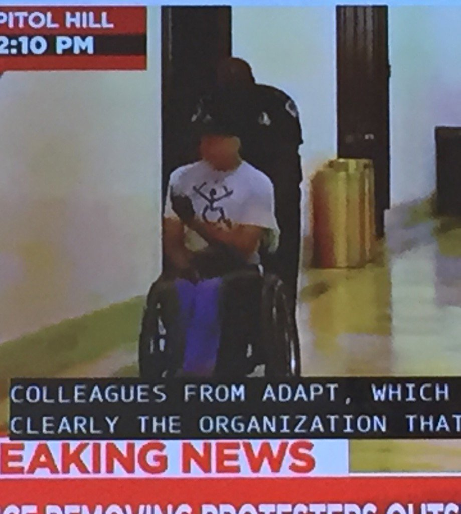 This dude giving the finger to McConnell is all of us today. #HealthcareBill
