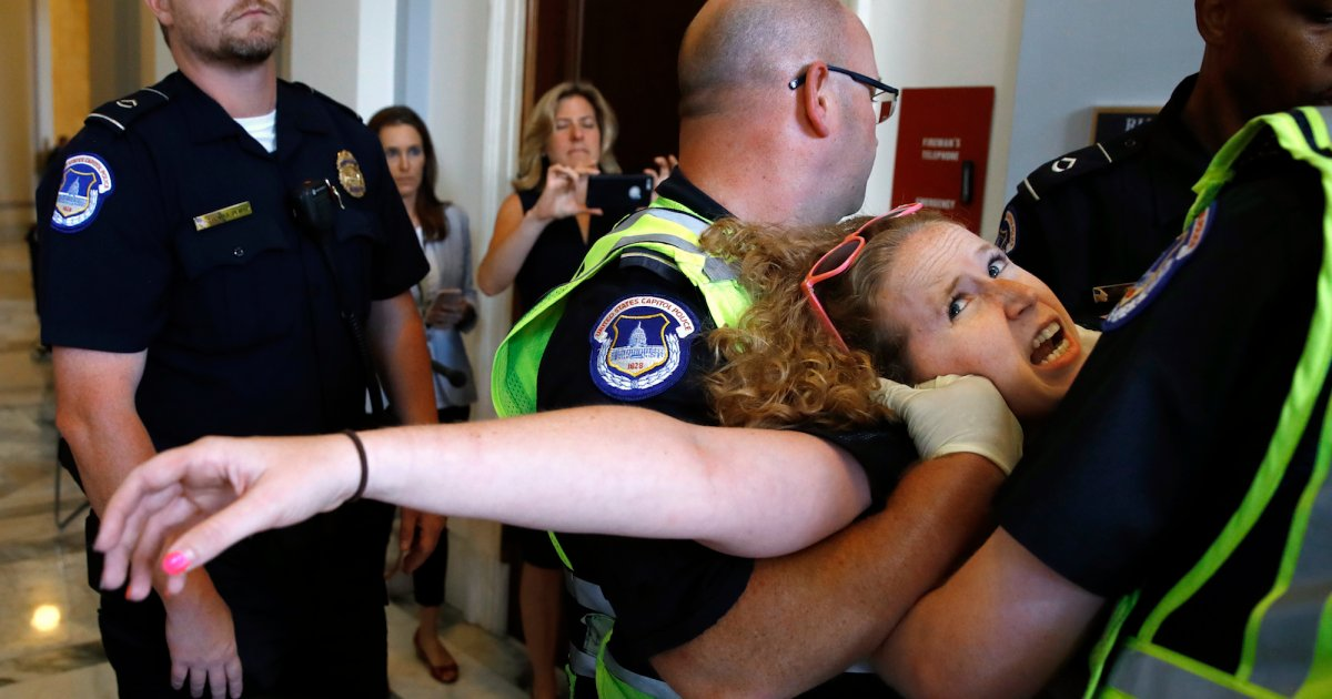 Police Remove Disabled Protesters Outside Mitch McConnell's Office