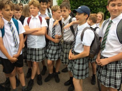 British schoolboys respond to shorts ban by wearing skirts