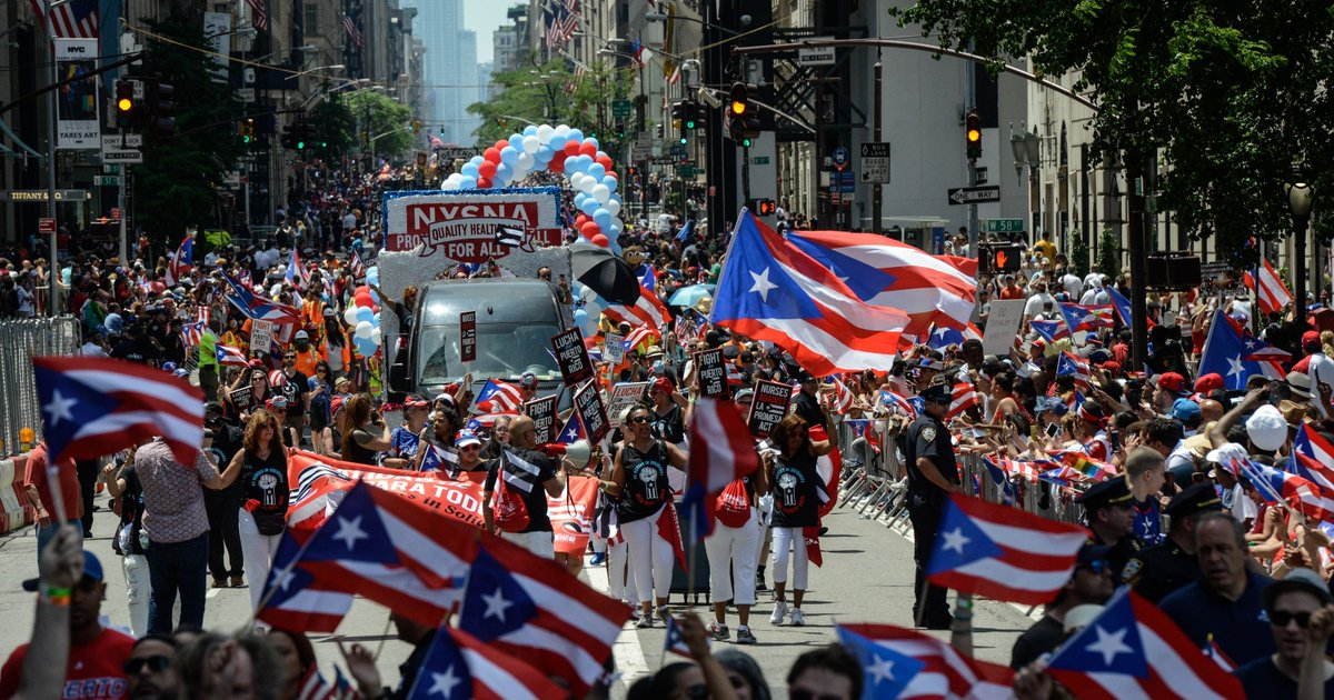 Puerto Ricans parade in New York, vote on the home island