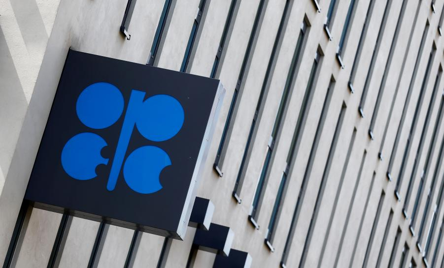 OPEC sees oil market rebalancing at slower pace, says output rises