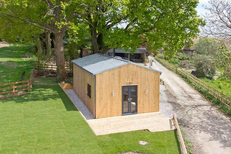 Run-down shed is transformed into stunning one-bed hideaway complete with swanky bathroom and modern furnishings – but it comes with £250k price tag
