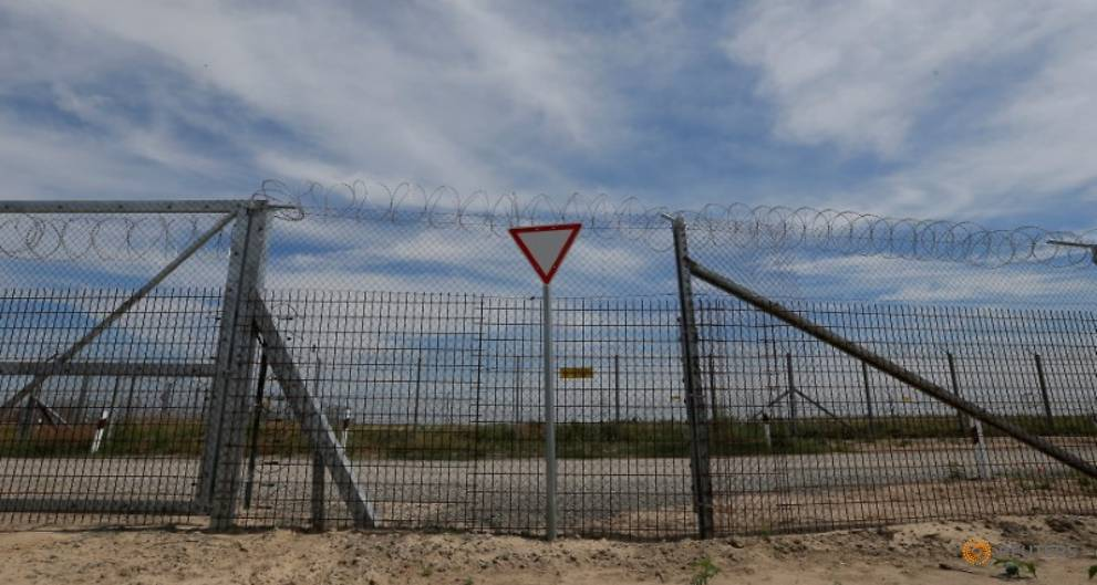 Hungary's tough asylum policy keeps thousands stranded in Serbia