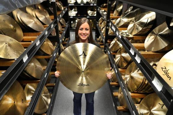 She helps Ringo Starr find the perfect cymbal