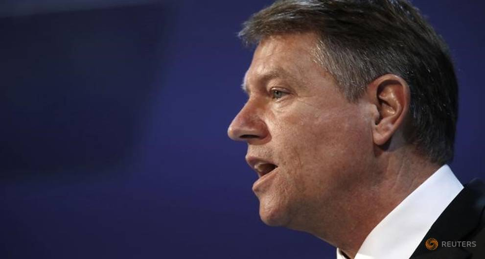 Romania's president asks ruling coalition to solve internal crisis