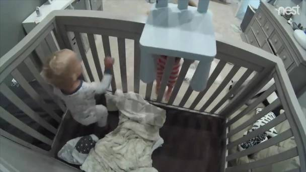 Caught on camera: Toddler helps baby brother out of his cot