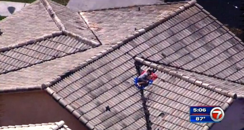 Missing boy who didn't want to go to camp found on roof by TV news chopper