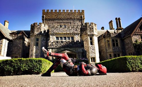 Ryan Reynolds poses for a photo in front of the X-Mansion to tease