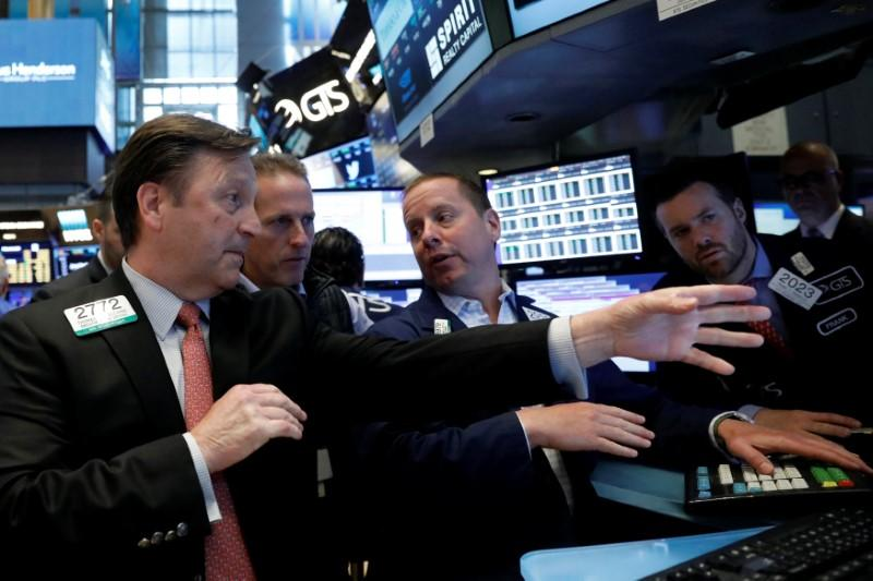 Wall St. at record highs on technology, health stocks strength
