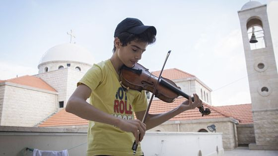 Historic violin lent by Oxford University to Syrian refugee