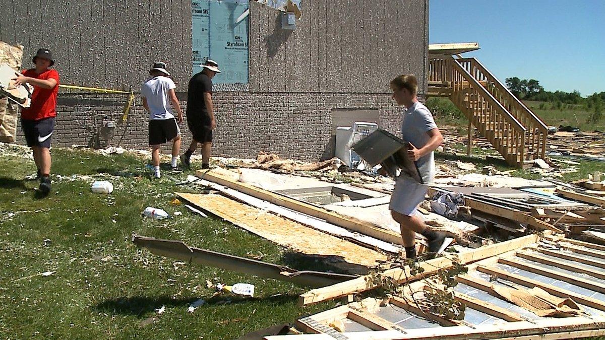 Football team tackles tornado cleanup
