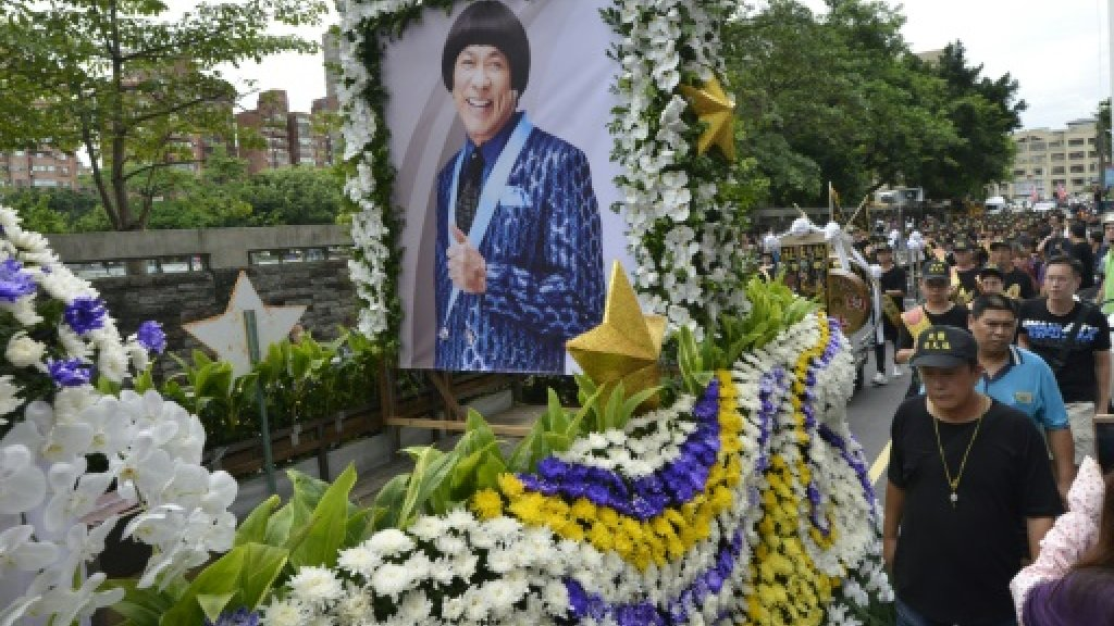 Thousands gather in Taiwan for festive celebrity funeral