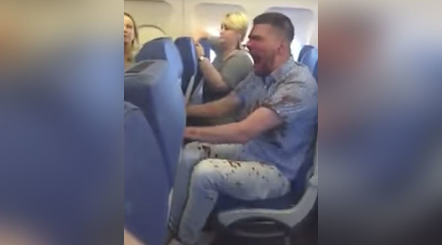 Bloodied drunk Russian man restrained after tirade onboard flight to Turkey (VIDEOS)