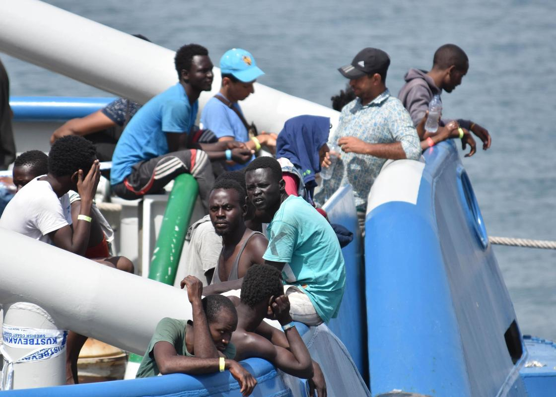 The Latest: Spain rescues 3 migrants, searches for 49 others