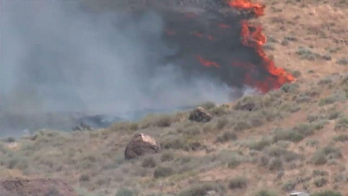 Winds fan 2 Nevada wildfires burning in rugged terrain