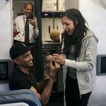 Couple gets engaged on Delta flight | AJC@ATL