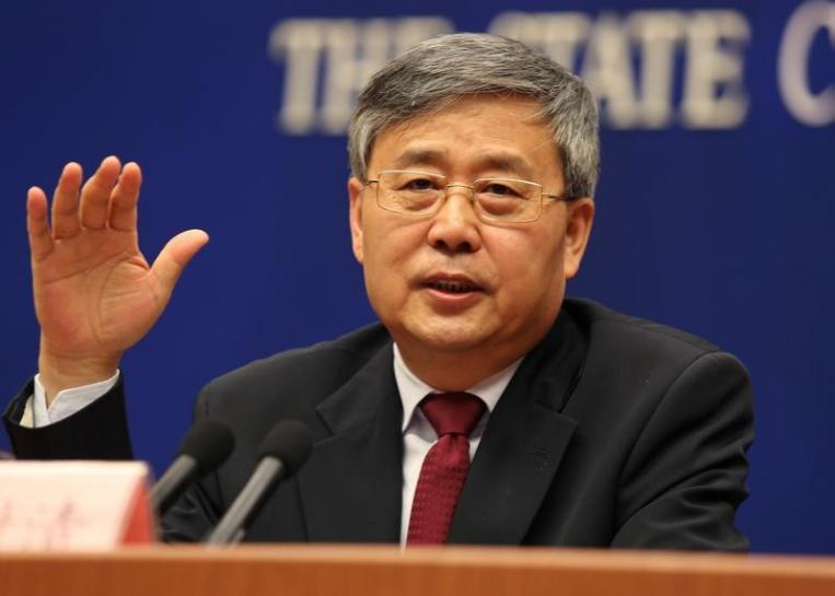 China's top banking regulator tells banks to push forward with reform
