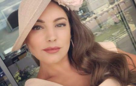 Kelly Brook looks chic in a cream dress and hat as she enjoys Ascot with boyfriend