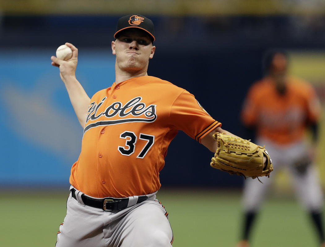 O's avoid dubious mark, Bundy goes 7 innings to top Rays 8-3