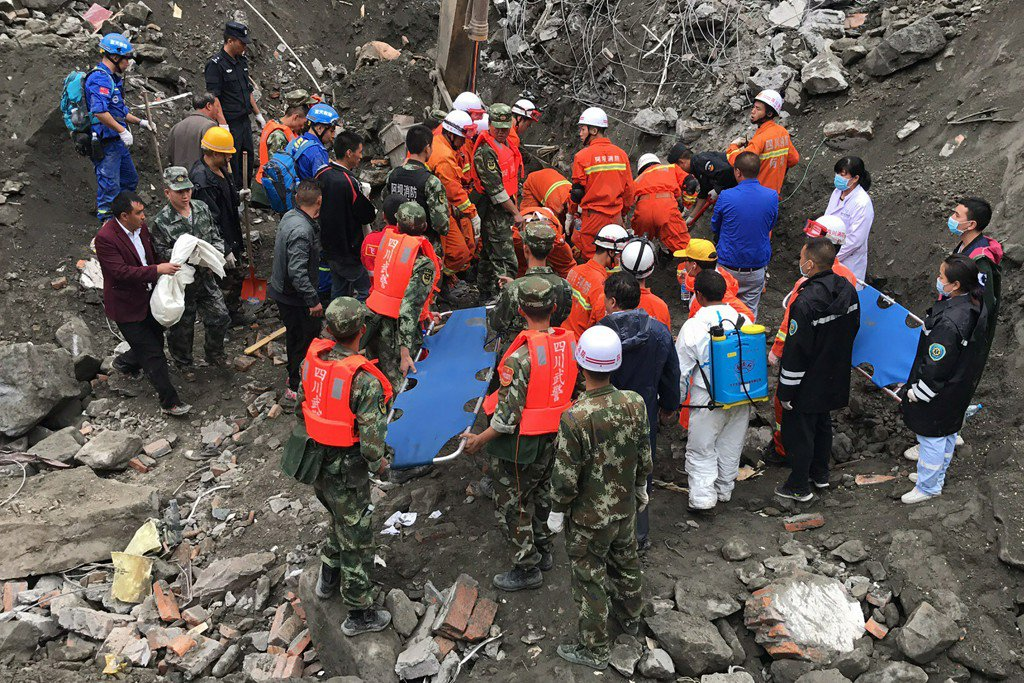 10 bodies found, scores missing in massive China landslide