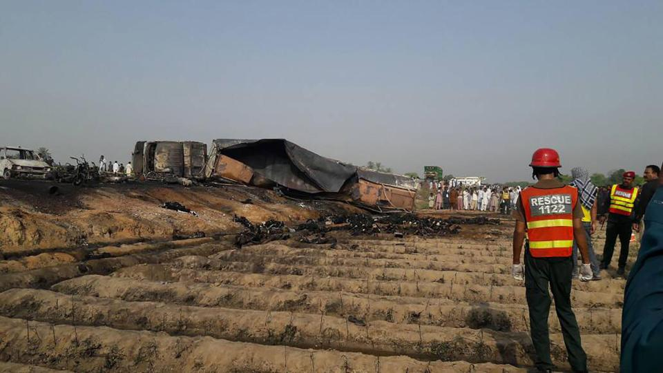 At least 123 people burned alive after rushing to collect fuel from overturned oil tanker when it burst into flames in Pakistan
