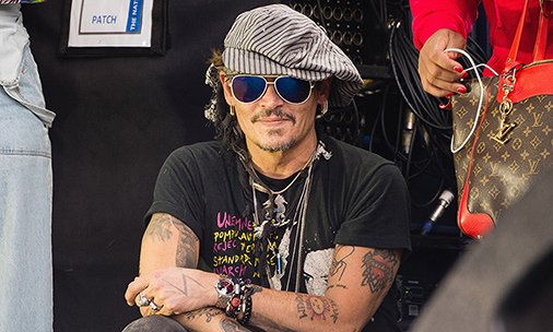 Johnny Depp, Brad Pitt and Bradley Cooper went to this year's Glastonbury! See the photos: