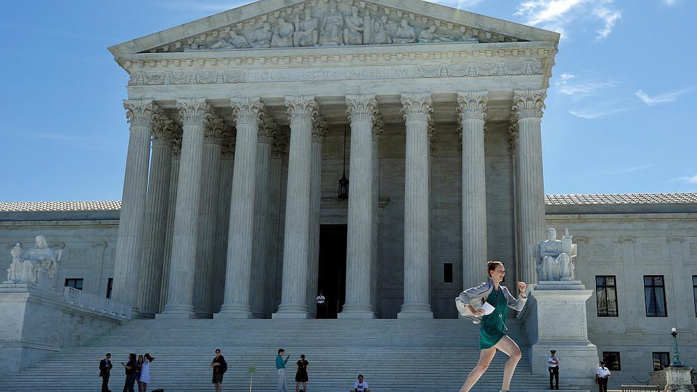 U.S. Supreme Court revives parts of Trump's travel ban