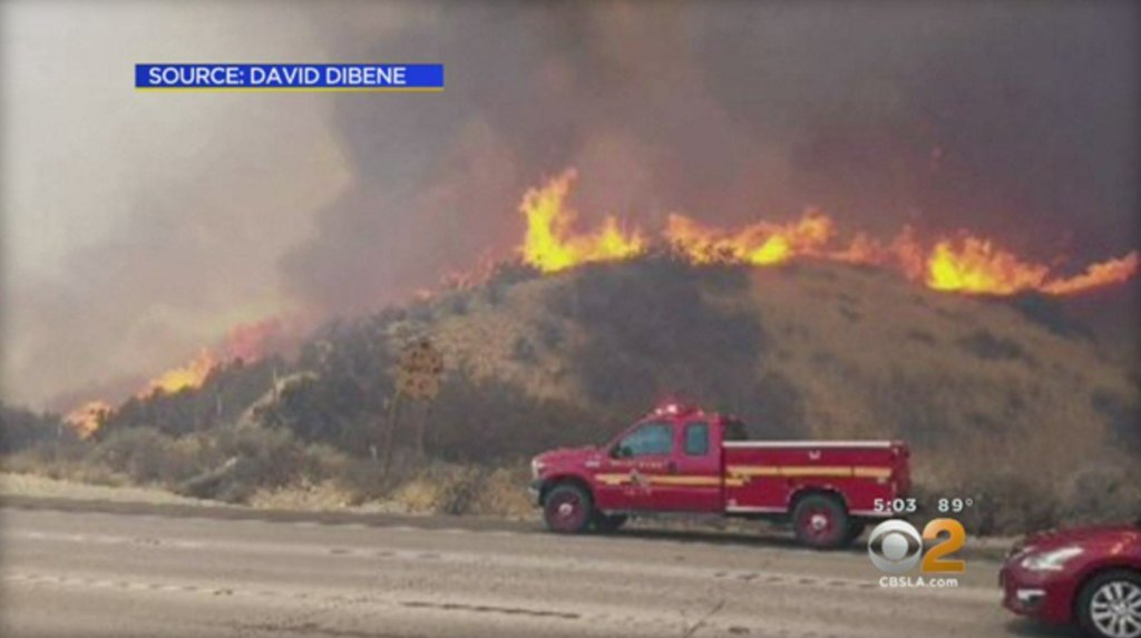 Wildfires in Utah and California burn hundreds of acres and prompt evacuations: