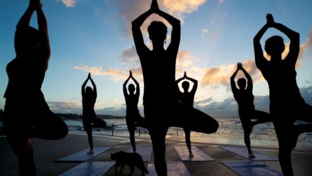 Corporate burnout: Professional women giving up their jobs to teach yoga