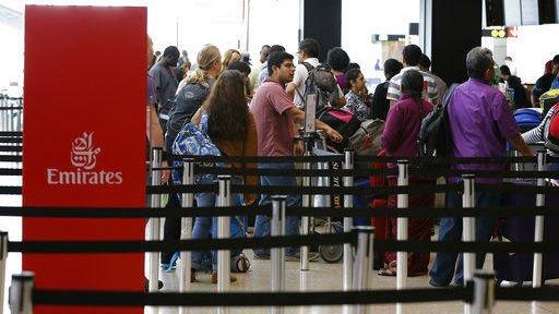 The Latest: Iranians brush off US travel ban
