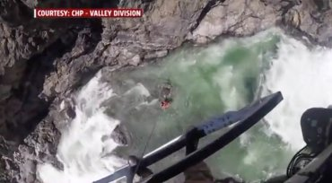 Video shows man swept away by California river narrowly avoid 'certain death'